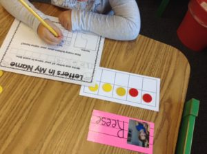 kindergartener writing