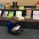 Boy reading at the book fair.