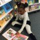 Girl reading at the book fair.