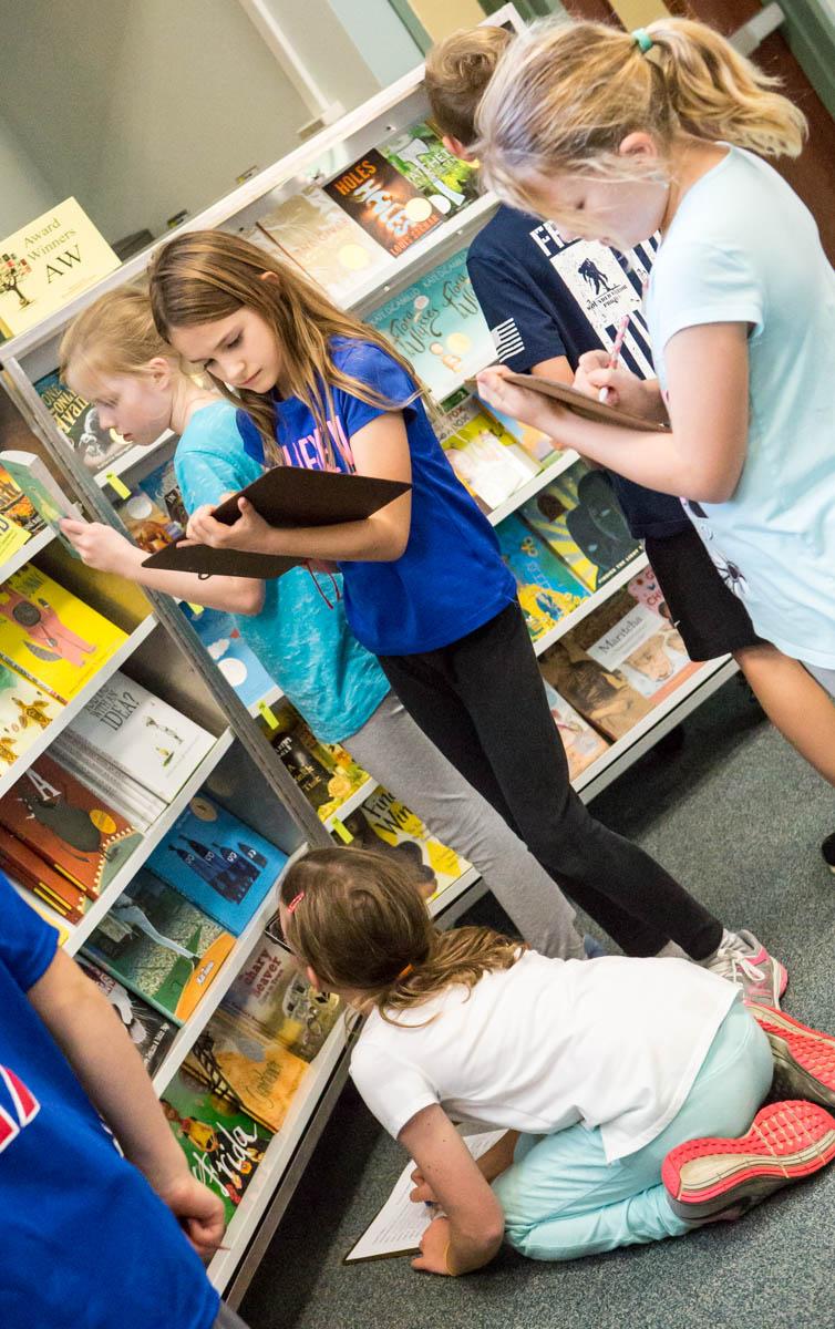 Girls browsing book fair