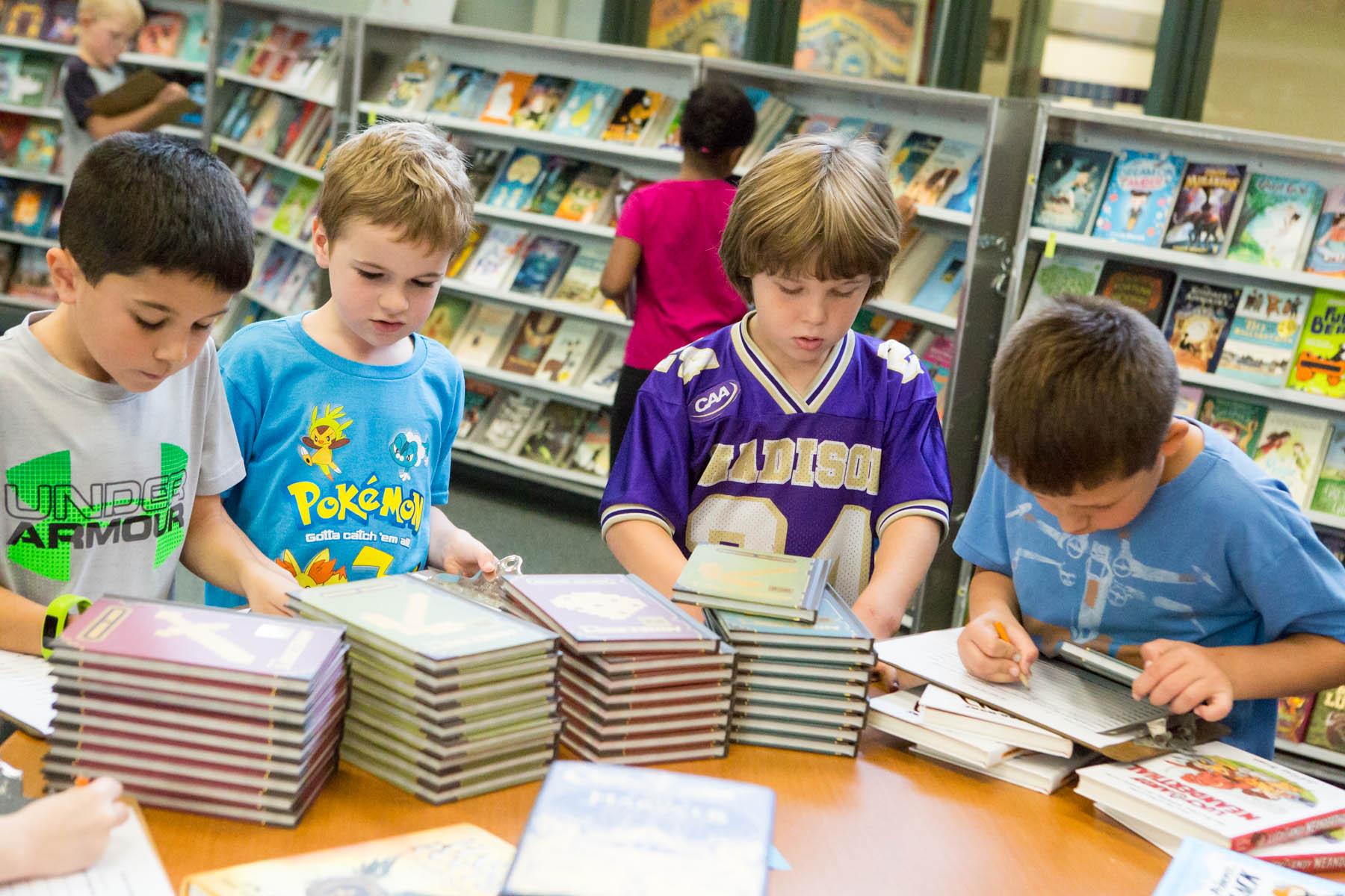 Boys browsing book fair
