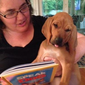 Nicole Gustafson reading to her dog.