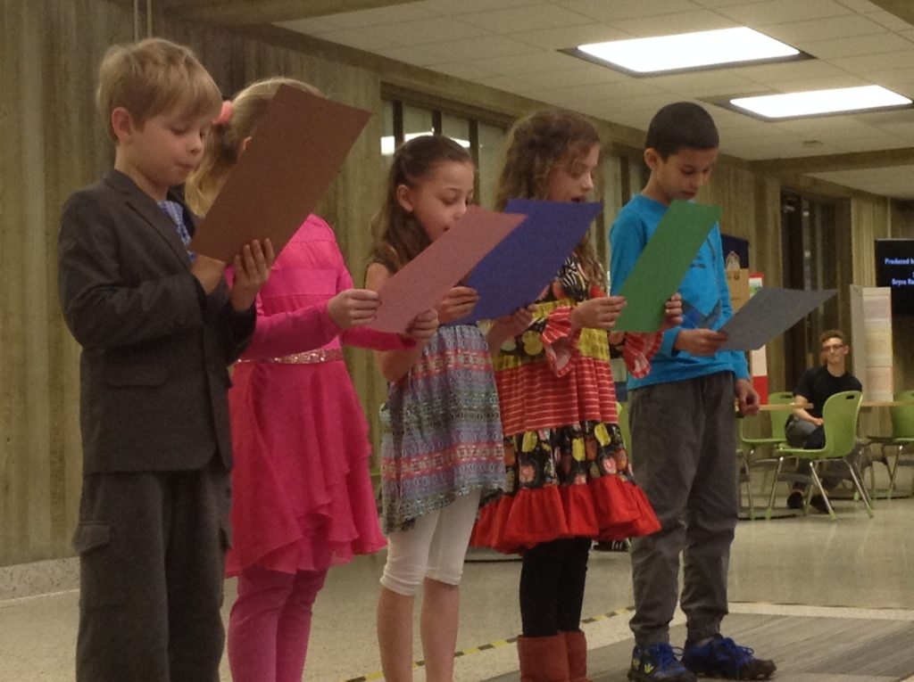 2nd graders reading/reciting poetry in Spanish